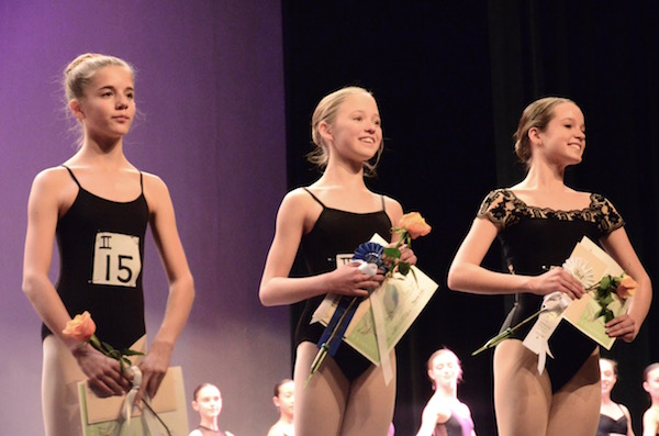 All finalists receive performance awards that can be used to further their dance education. Here, the top three winners in Category II (ages 12-13) receive their awards. At center is Lydia Foley, winner of the 1st Place Award in her age category and the David Parvin Award for Outstanding Young Artist. Photo: Kathy Wells.