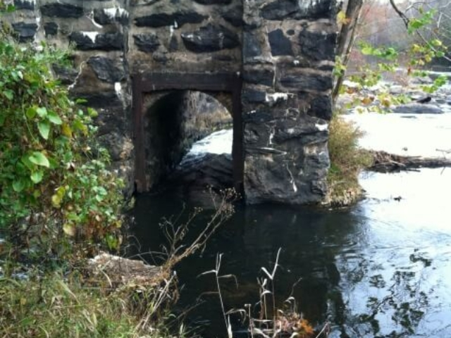 a photo of the stonework channel in the river that allows safe passage around the dam at Indian Valley