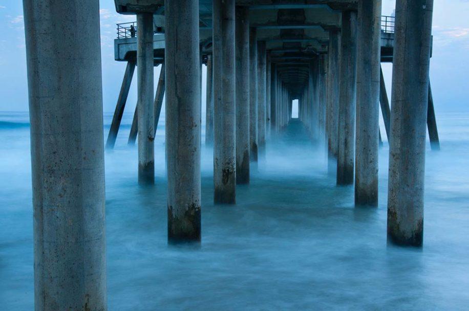 A long exposure under the Huntington Beach pier by Greg Tucker