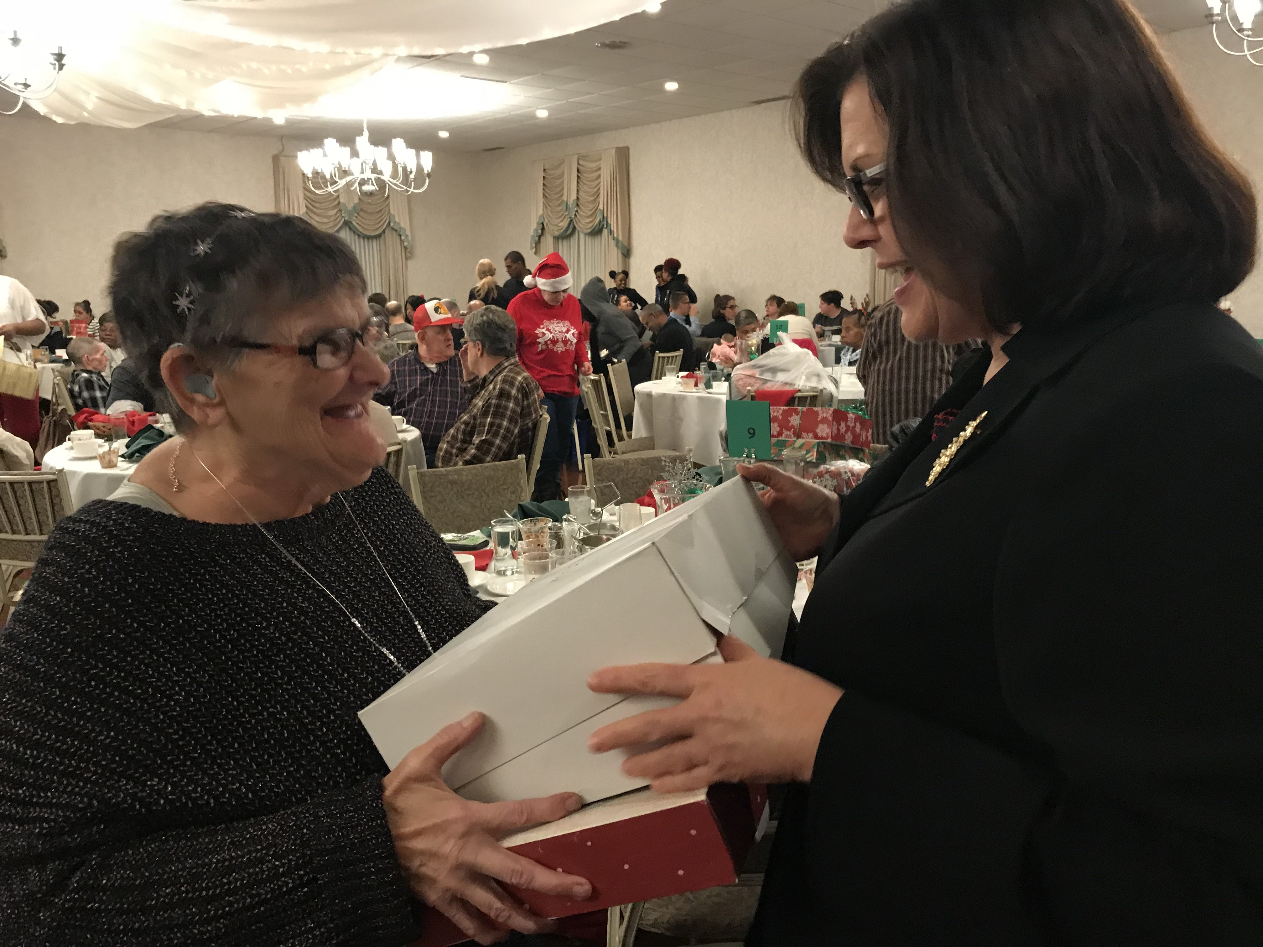 Diane Beastrom enjoying the holiday party with a Koinonia client