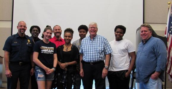 Those involved in the summer work program at the city of Stow include from left; Assistant Fire Chief Mike Lang, Phil Gibson, job coach with Koinonia; Melody Brajer, Matt Magaw, job coach with Koinonia; Ashley White, Tyrese White, Mayor James Costello, Jere'maiah Smith; and Jeffrey B. Shaver, utility superintendent