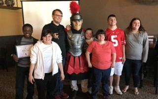 From left to right, Abraham Konneh, Erica Summerfield, Griffin Strickler, Springfield Spartans Mascot, Jenna Holmes, Katelyn, Austin Loar, and Courtney Conley