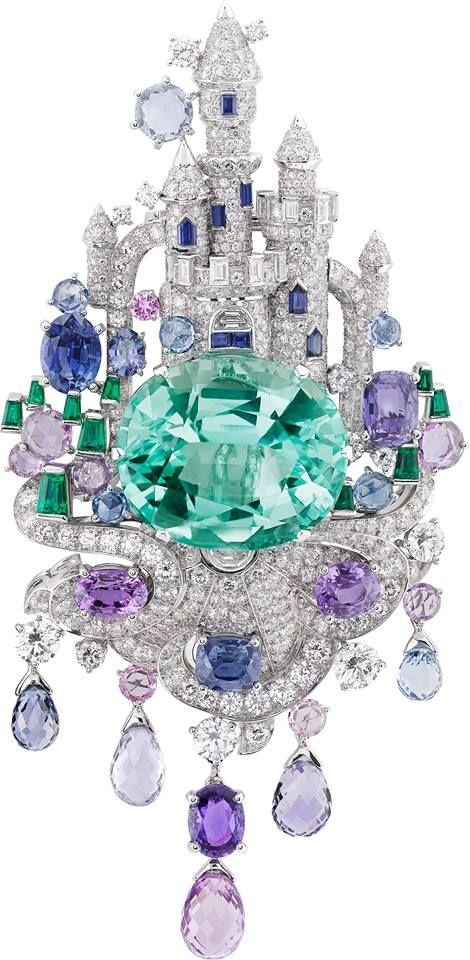 Van Cleef & Arpels' Château Enchanté clip, Fantasy castle created with diamonds and multi-colored sapphires, sitting atop an oval-cut Brazilian paraiba tourmaline of 39.85 carats.
