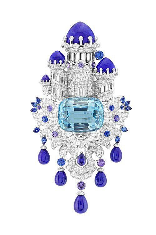 Van Cleef & Arpels' Château Enchanté clip, Fantasy castle created with diamonds and tanzanites, sitting atop an beautiful Brazilian aquamarine gem.
