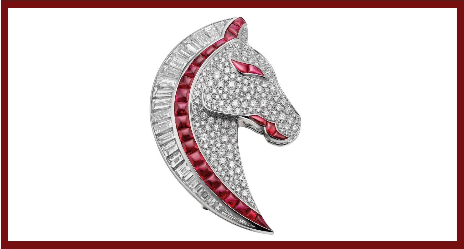 This horse head brooch is made with 18k white gold with 26 rubies, 24 trapezoidal step diamonds and diamond pavé
