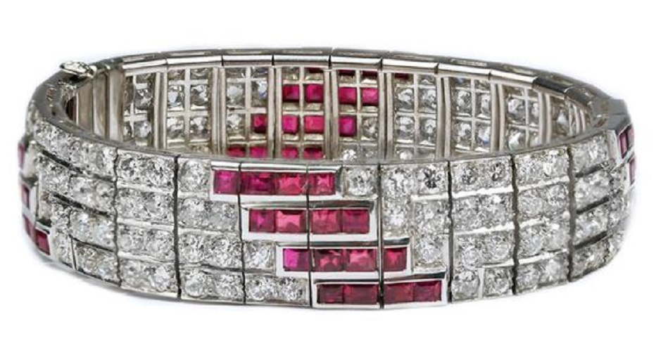 Ruby and Diamond Art Deco Platinum Bracelet, accompanied by approximately 13.00 carats of Diamonds and 4.00-5.00 carats of Rubies. Set in Platinum.