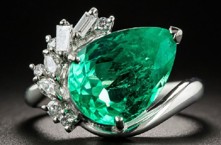 4.48 CARAT PEAR SHAPED COLOMBIAN EMERALD PLATINUM AND DIAMOND RING $11,750.00