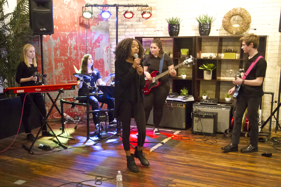 Triumph Music Academy provides all kinds of performance opportunities, like this one for a student band.