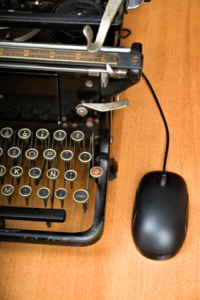 typewriter with compter mouse attached