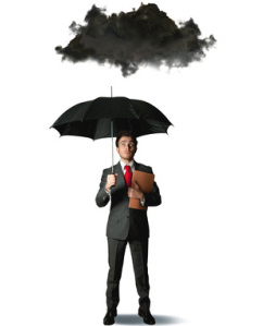 man standing under umbrella and black cloud