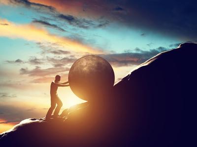 Sisyphus metaphor. Man rolling huge concrete ball up hill. Sisyphean work, task.