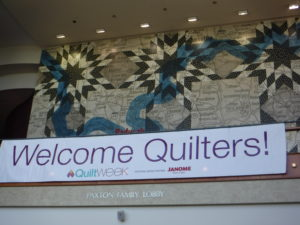 a huge quilt-themed welcome sign