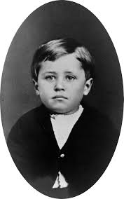 Image of a young boy in 1876s clothing