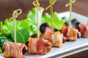 Multiple dates and bacon skewers.