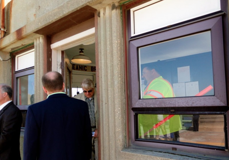Rumson Mayor John Ekdahl takes a tour of the gatekeeper's quarters of the Oceanic Bridge in 2012. Photo/Elaine Van Develde