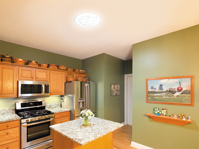 Kitchen being filled with light from tubular skylight lighting.