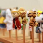 Toy puppets on wooden sticks for preschool nursery theatre. Puppet theatre art.