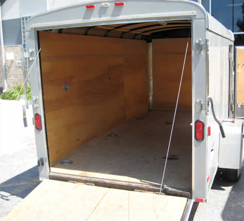 Back of our gray 6′ x 12′ enclosed cargo trailer.