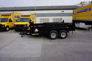 Left side of 6' x 12' Tandem Axle Dump Trailer for rent [5970]