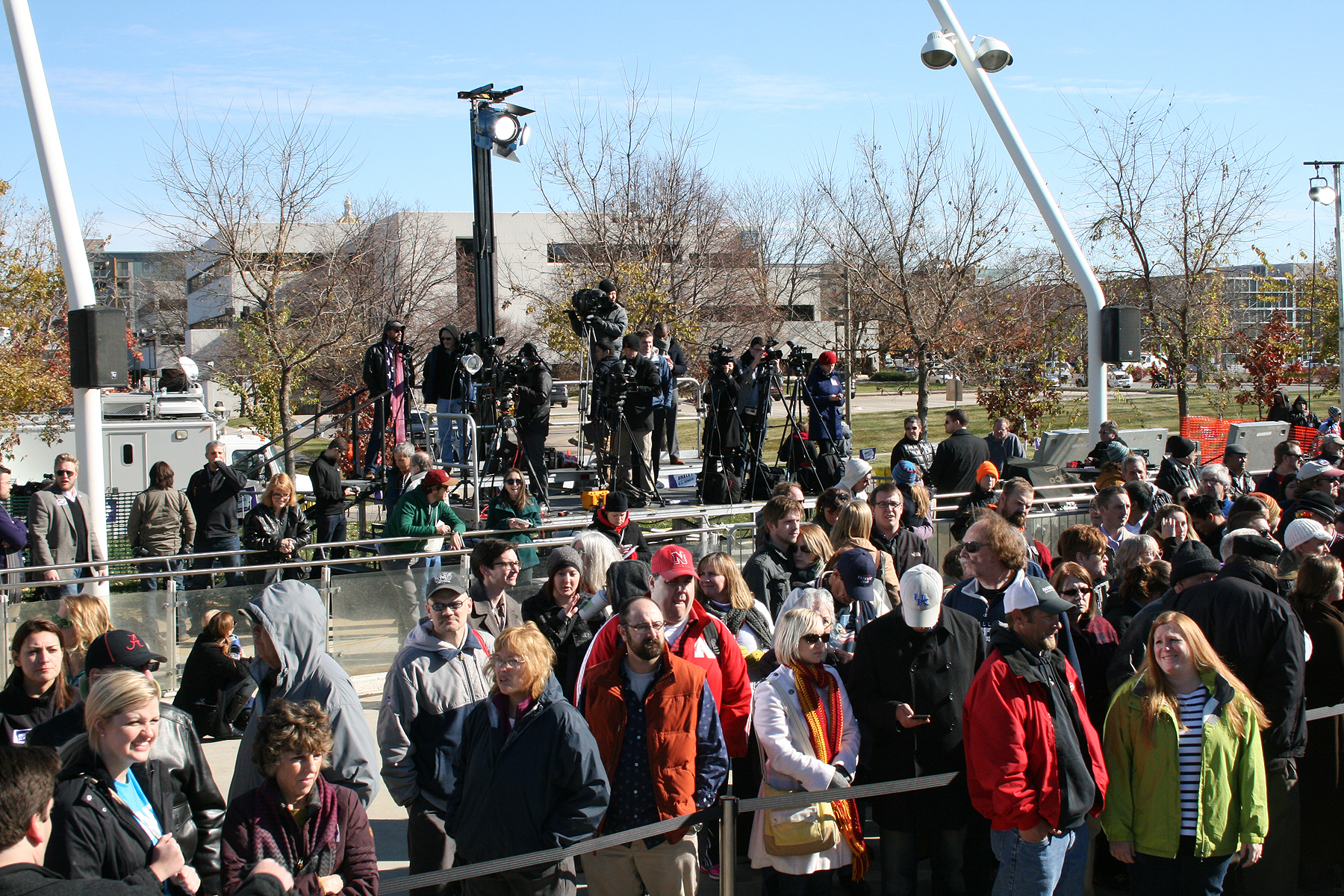 Spectators in front of Two Tiered Press Riser