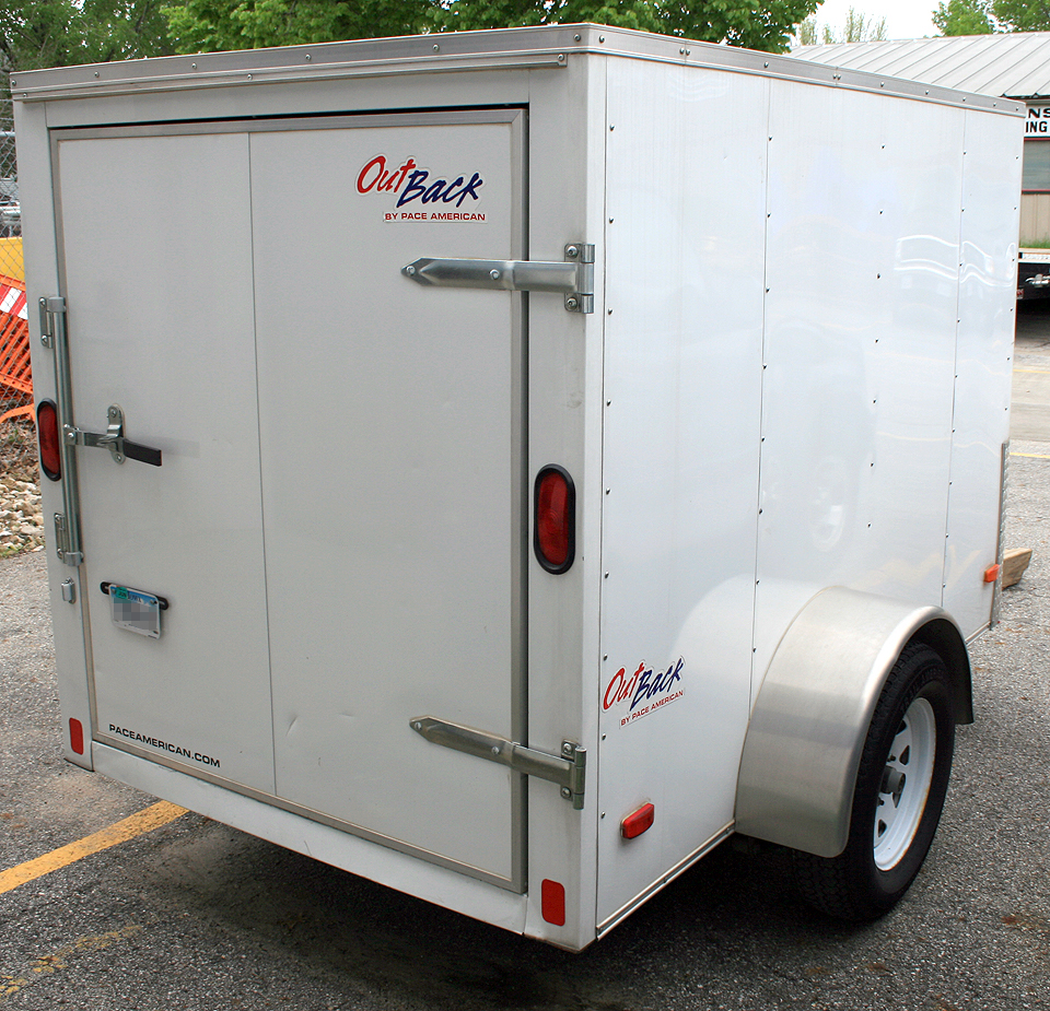 Back right side view of our 5'x8′ enclosed trailer for rent.