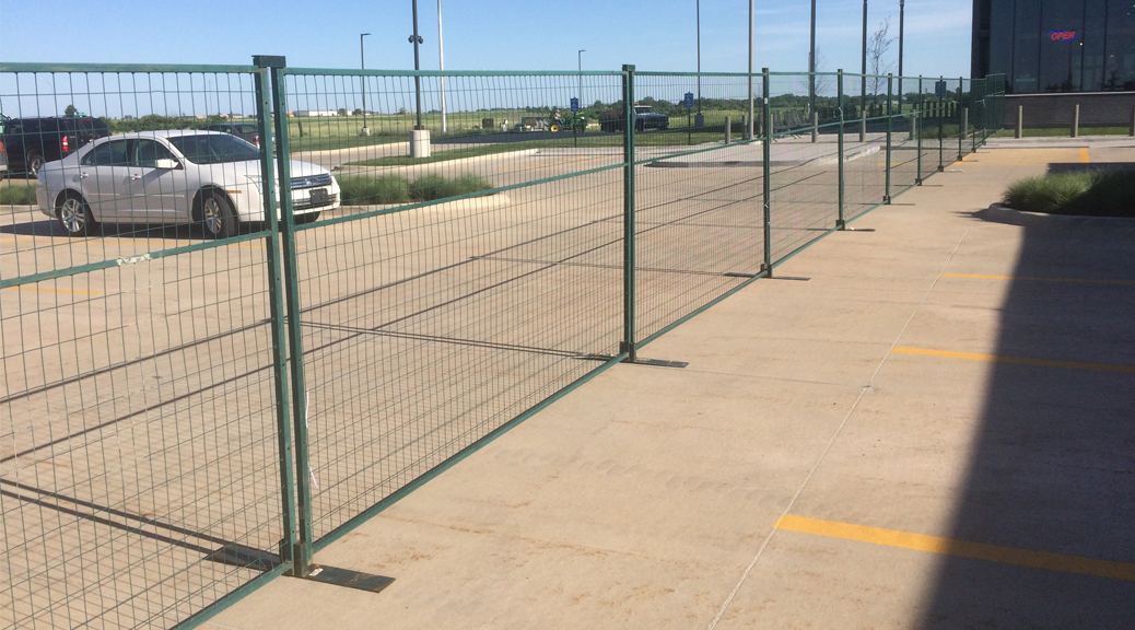 Green temporary security fencing. Event perimeter barricade