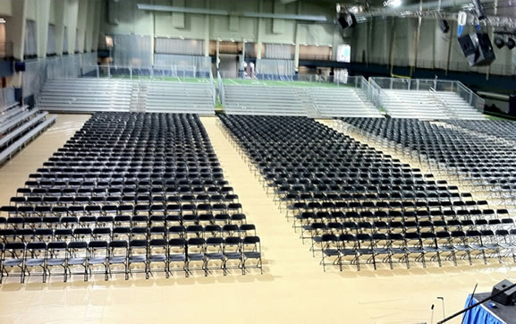 Graduation ceremony with chairs, bleachers, pipe & drape, podium and more from Big Ten Rentals.