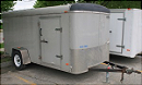 Pewter 6' x 12' enclosed cargo utility trailer with side access door.