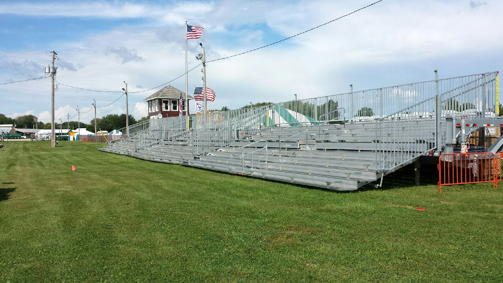 Three sets of 45′ long, 10-Row Hydraulic Bleachers in a line.