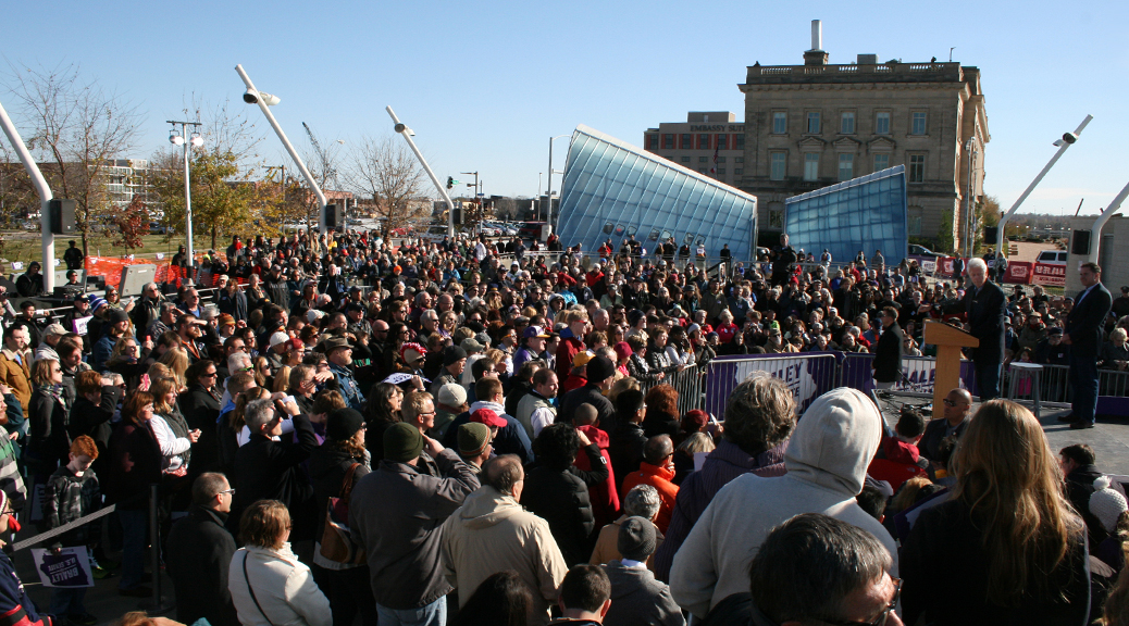 President Bill Clinton at political event with large crowd of people