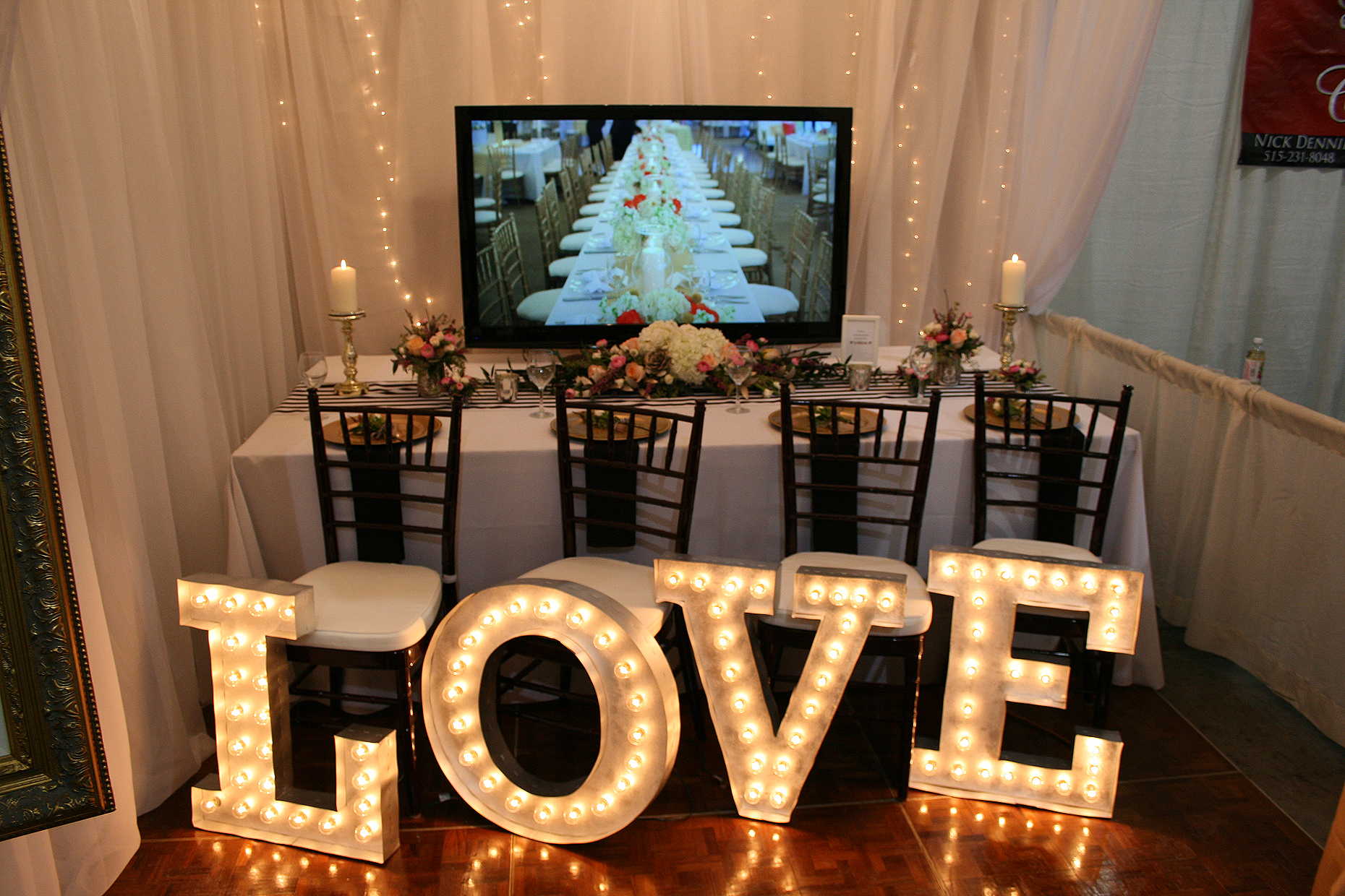 Wedding Booth with flowers and lighting