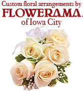 The stunning floral arrangements for our booth were custom created by the staff at Flowerama in Iowa City.