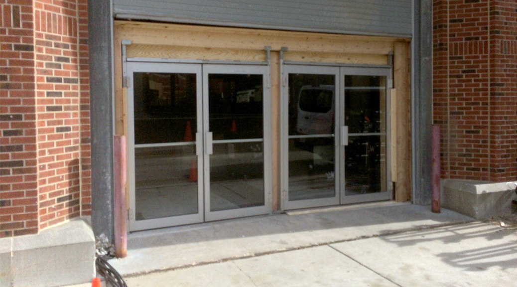 Adding double glass door fire exits to event hall to increase total capacity
