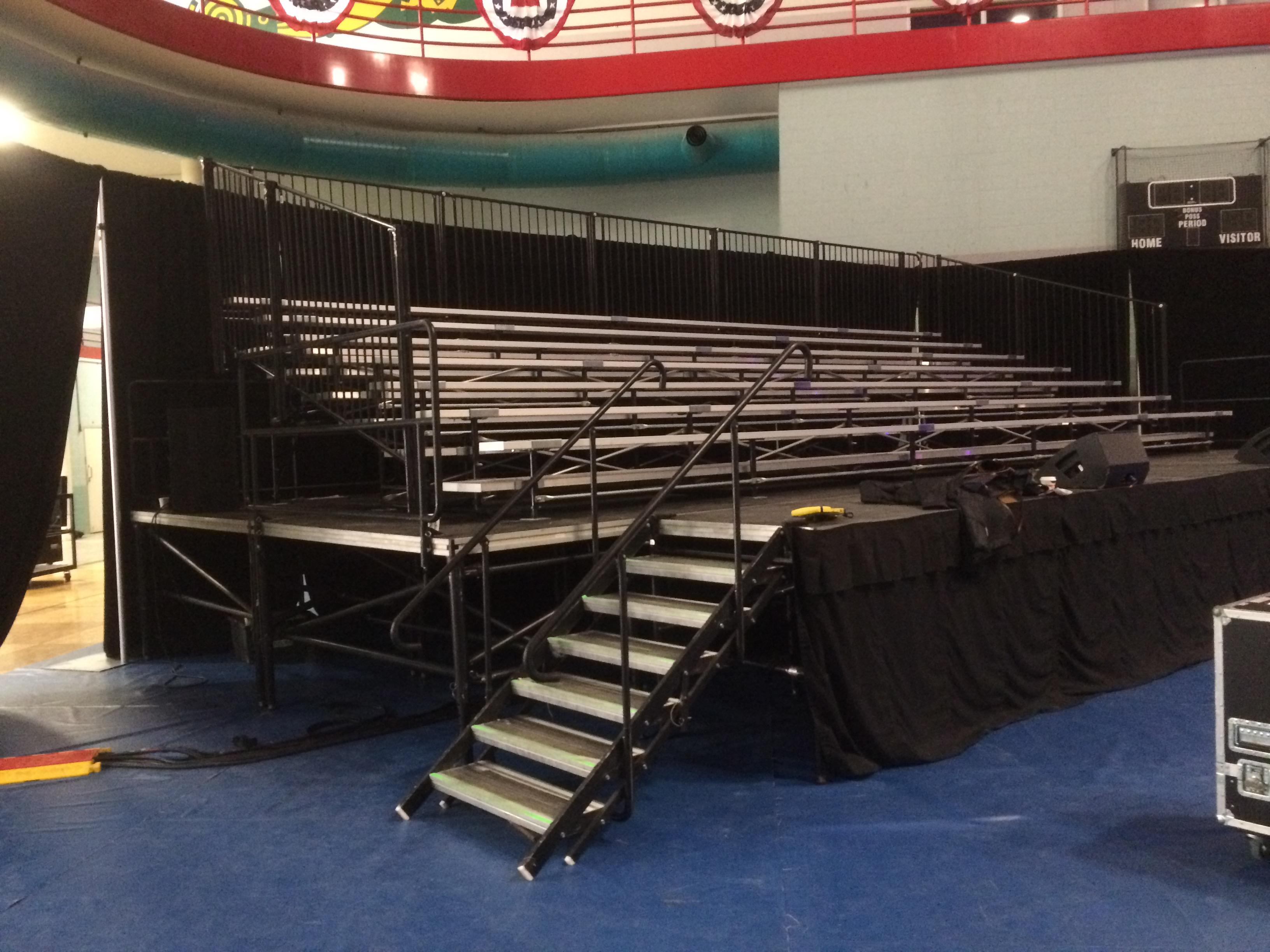 Elevated 7-row x 32′ long granite bleacher seats 168 with no aisle political event