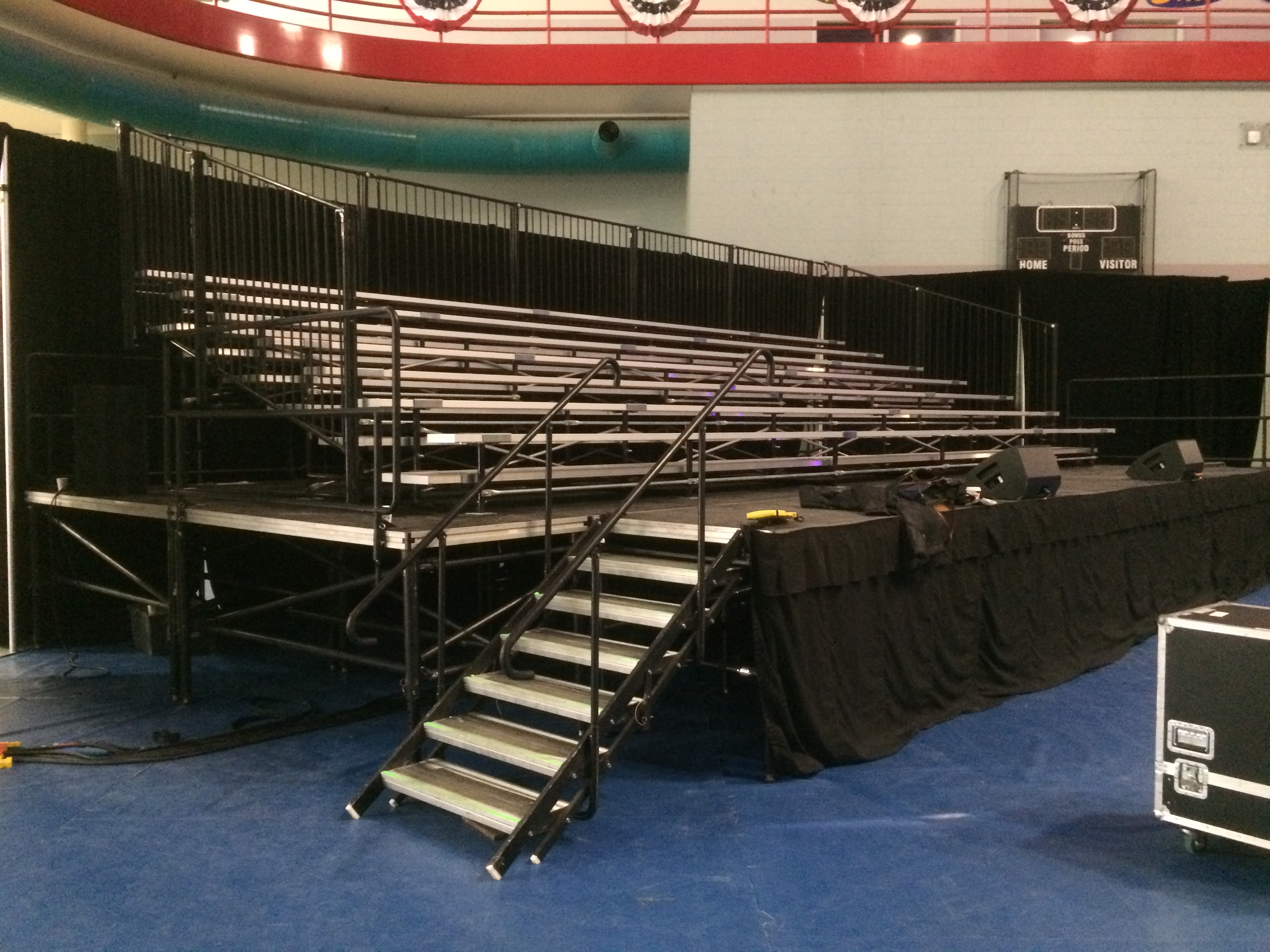 Raised 7-row x 32′ long granite bleacher seats 168 with no aisle political event