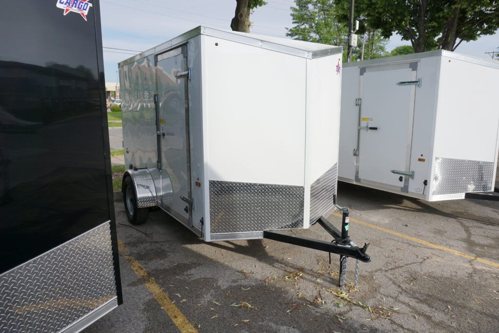 Right side of White 6'x10' enclosed cargo trailer Vin Number 2803