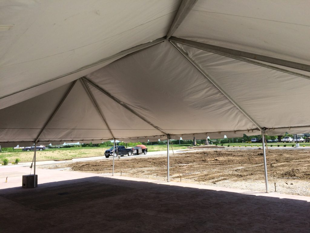 Under 30' x 45' Frame tent set up at Two Rivers Bank & Trust grand opening in Coralville, Iowa