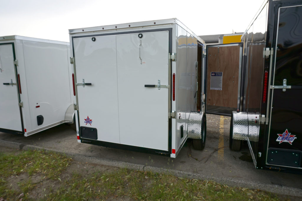 White 6'x10' enclosed cargo trailer Vin Number 2803 back with side door open