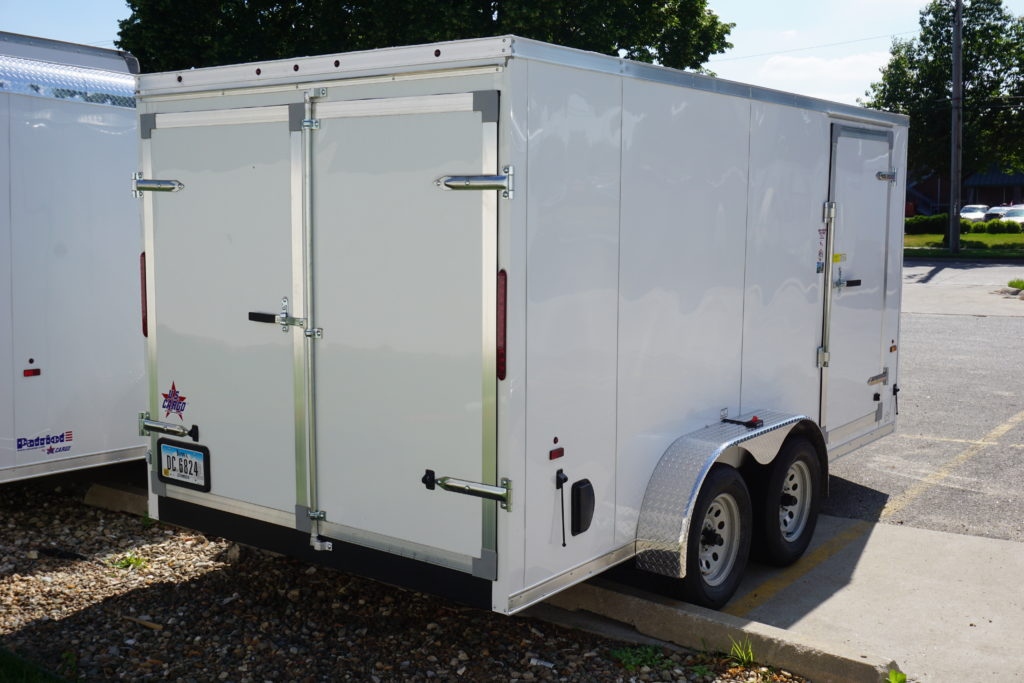 Back and side of 7'x14' white tandem enclosed trailer for rent or sale 2432