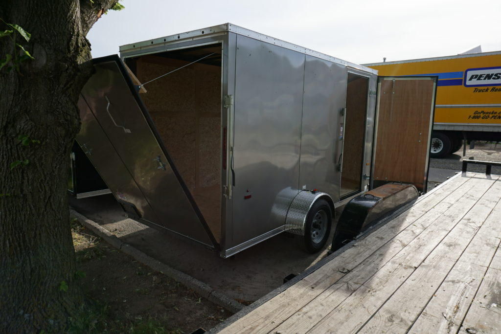 Back right side of pewter 6'x12' enclosed cargo trailer