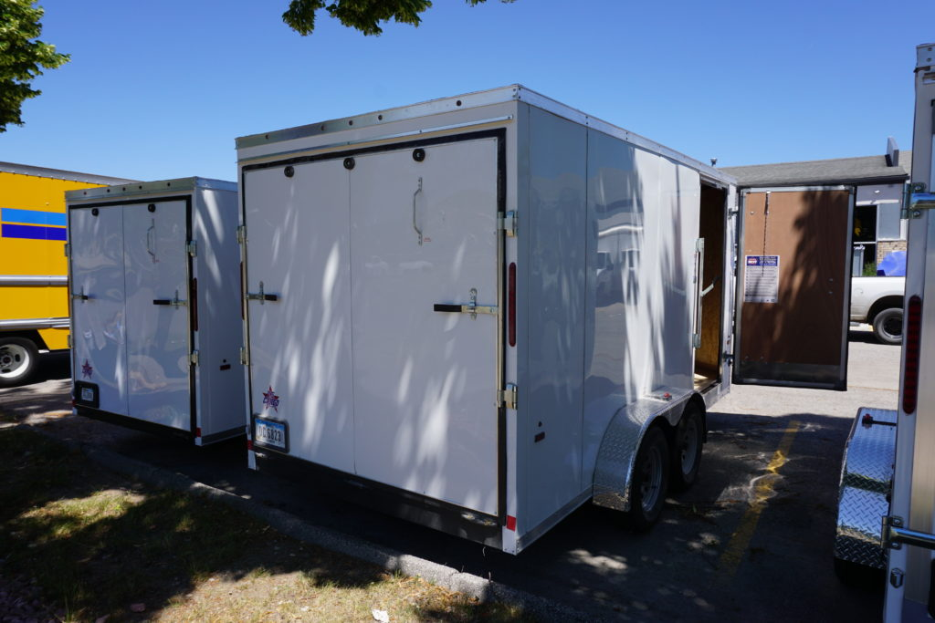 Back right with side door open on 7x14 white tandem enclosed trailer for rent or sale [sn2887]