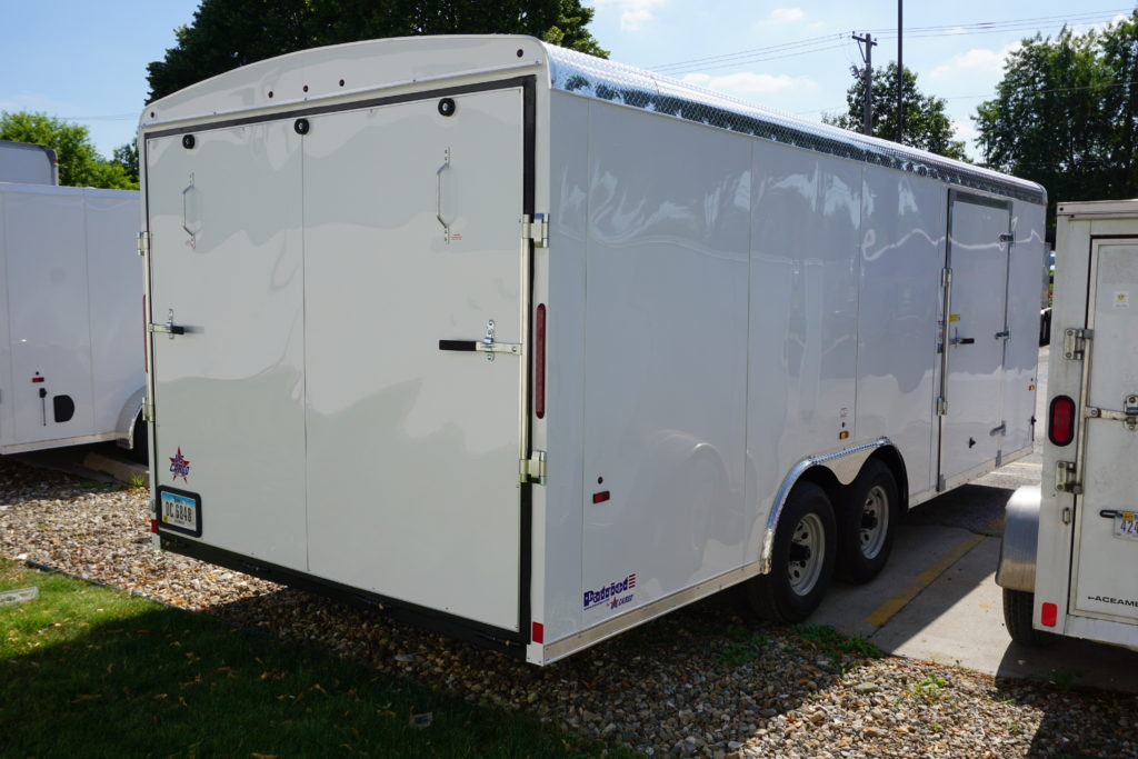 Back with side door of 8½' x 20' white tandem enclosed trailer for rent or sale [sn3283]