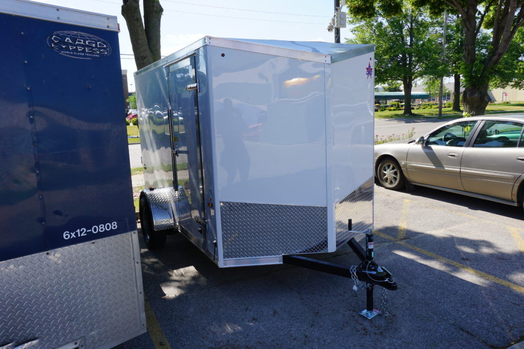 Front of 6' x 10' white single axle enclosed trailer [sn2852]