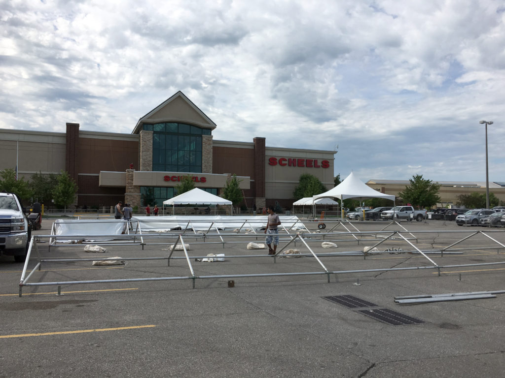 Setting up frame tents at Scheels in Des Moines, Iowa