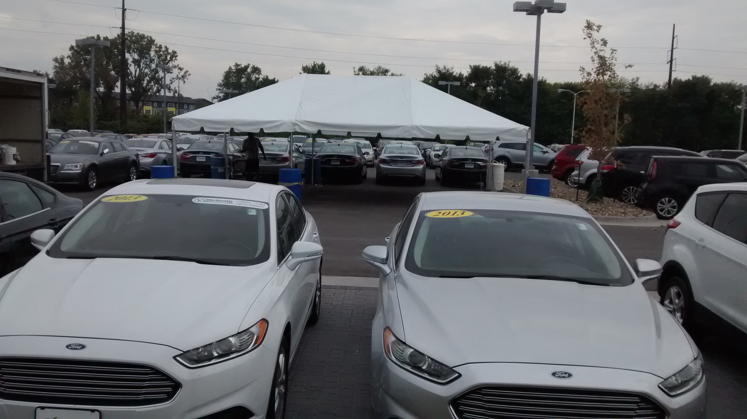 20′ x 30′ frame tent for the grand re-opening at Coralville Used Car Superstore view by cars