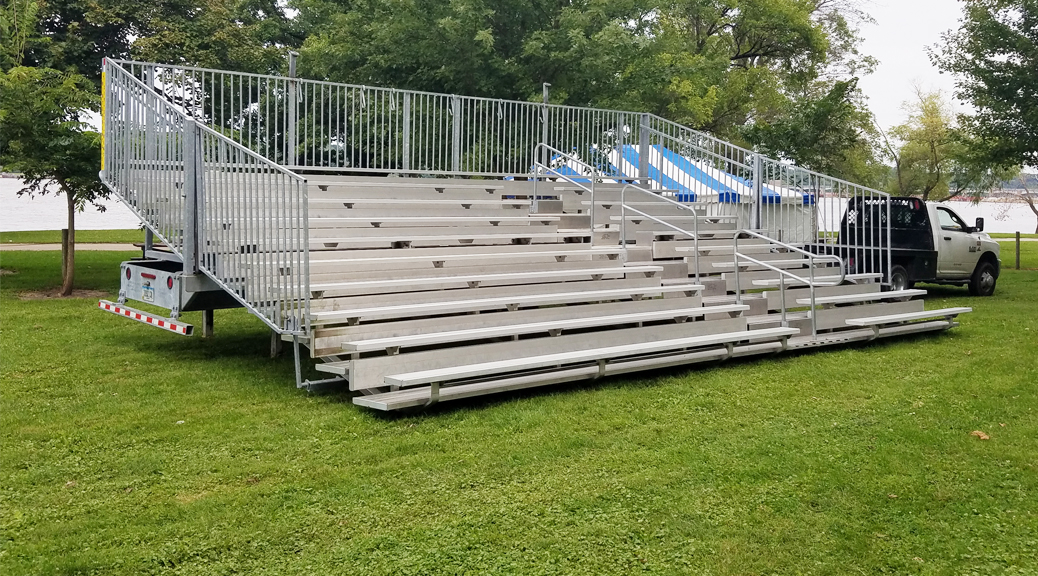 30' 10 Row Hydraulic bleachers at a political event for Hillary Clinton at Illiniwek Campground in Hampton, IL