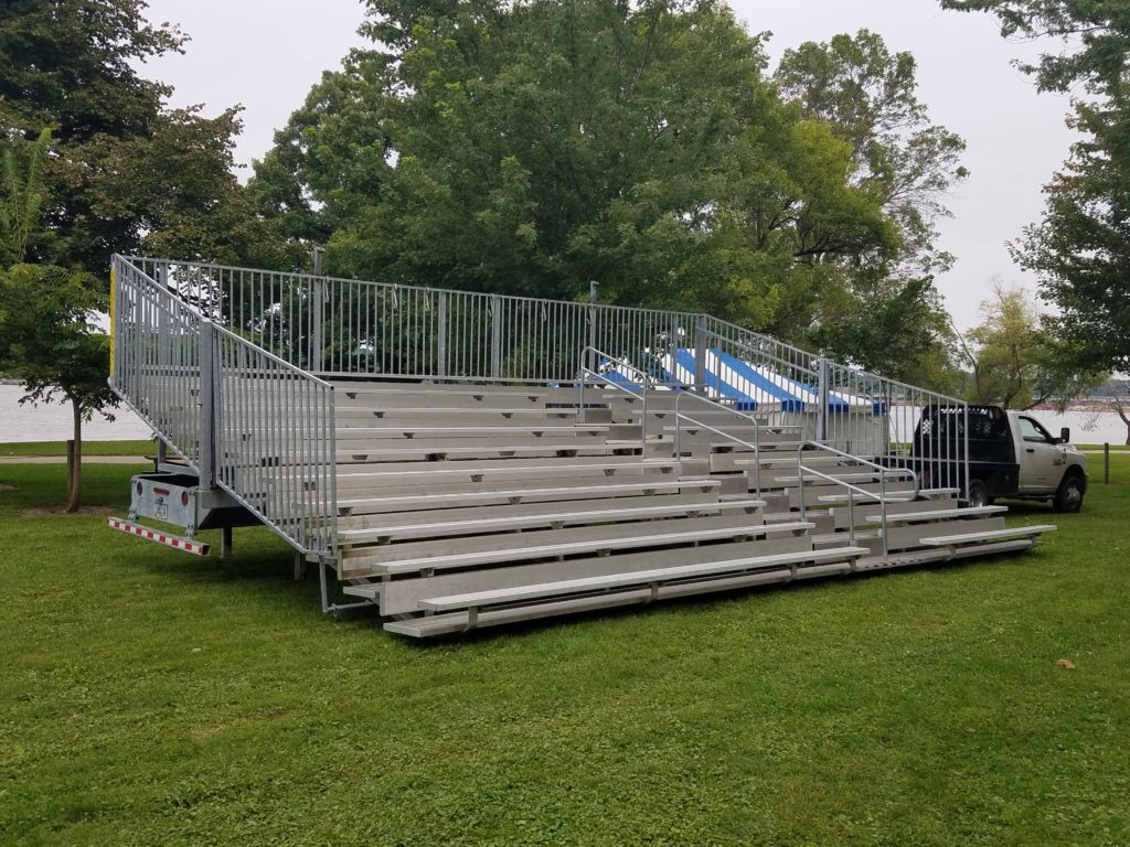 30' x 10 Row Hydraulic bleachers at a political event for Hillary Clinton at Illiniwek Campground in Hampton, IL