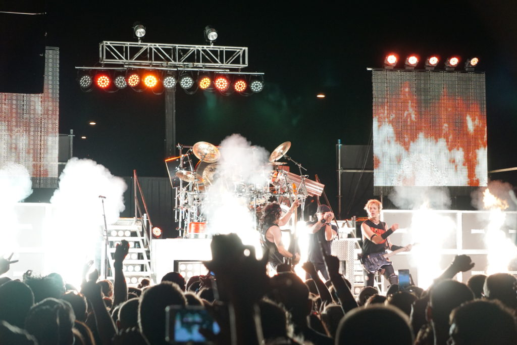 Closeup of Hairball cover band playing on stage at FRYfest block party