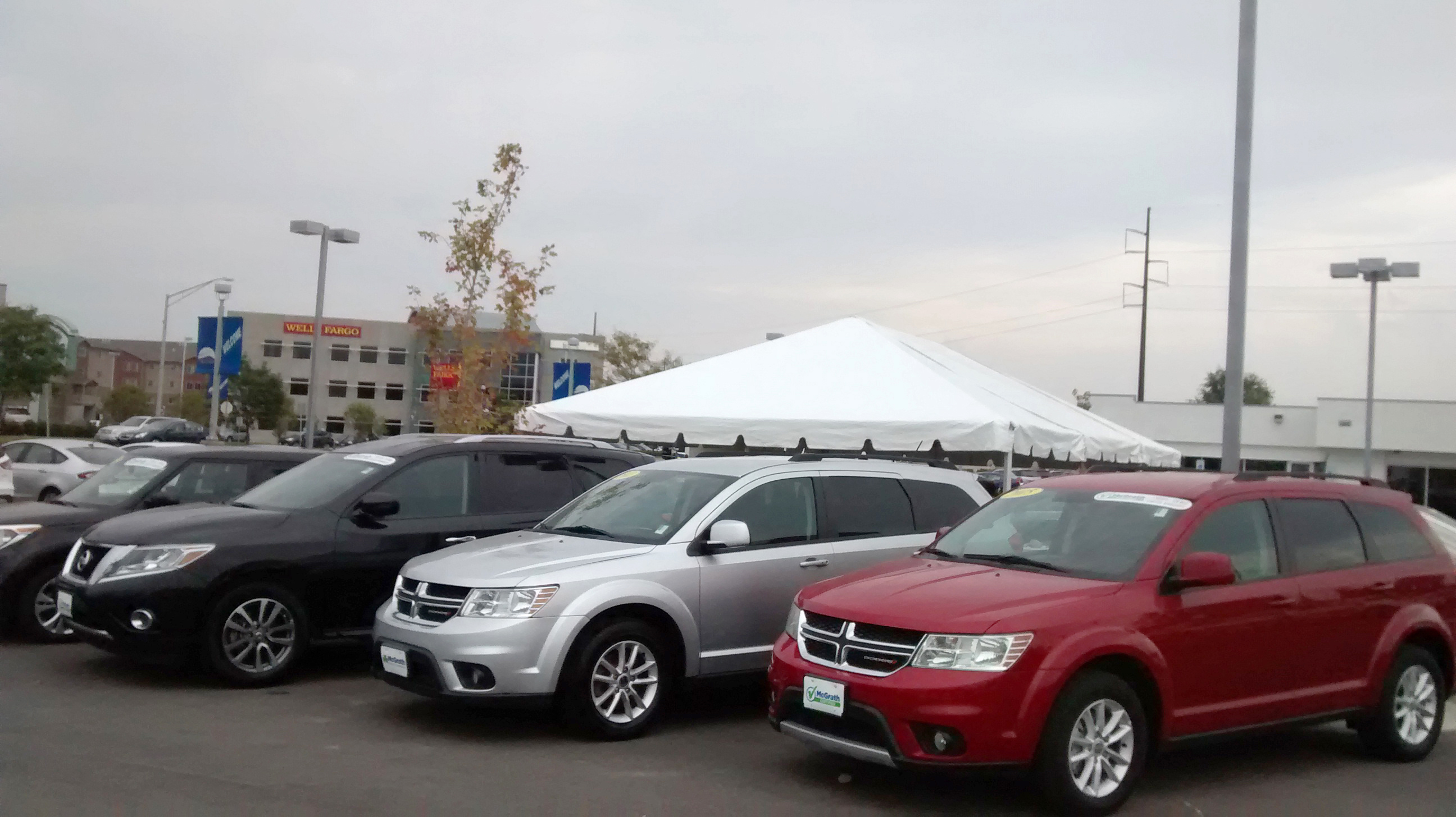 End of 20′ x 30′ frame tent for the grand re-opening at Coralville Used Car Superstore