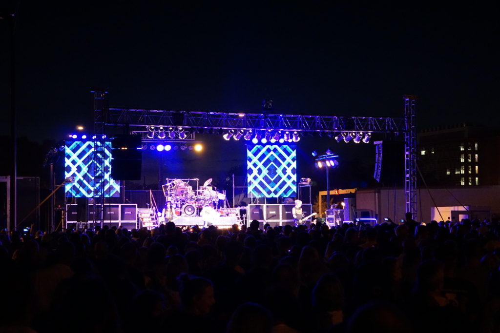 Full stage at FRYfest block party with Hairball band on it playing